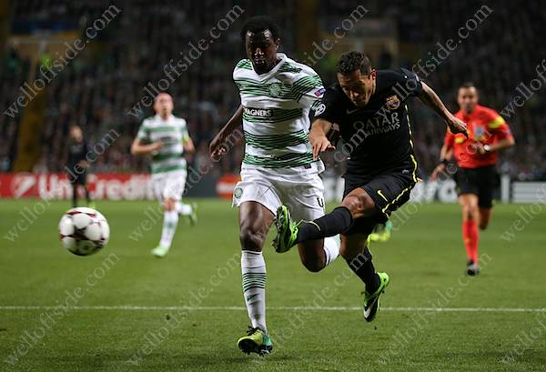 Adriano of Barcelona shoots past Efe Ambrose of Celtic