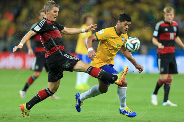 Bastian Schweinsteiger of Germany battles with Hulk of Brazil