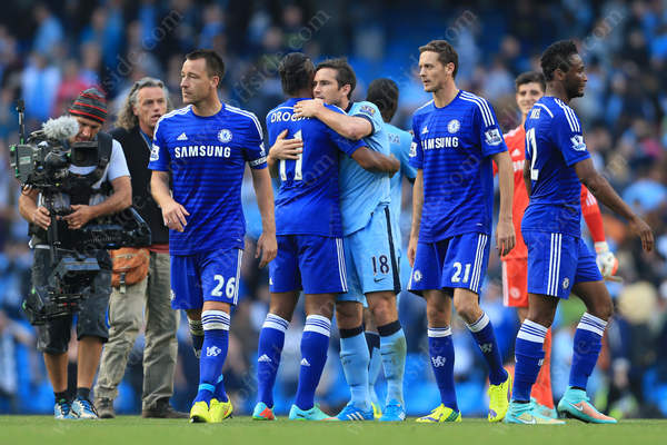 Frank Lampard of Man City embraces former teammate Didier Drogba of Chelsea after the match