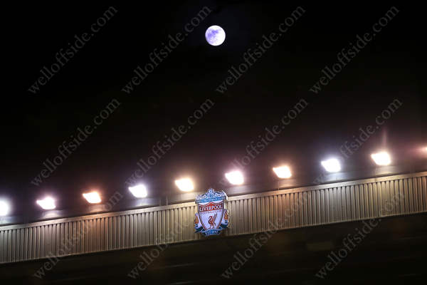 A full moon rises over the stand at Anfield