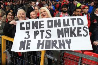 Man Utd fans hold up a banner in response to Man Utd manager Louis van Gaal's request for horny football